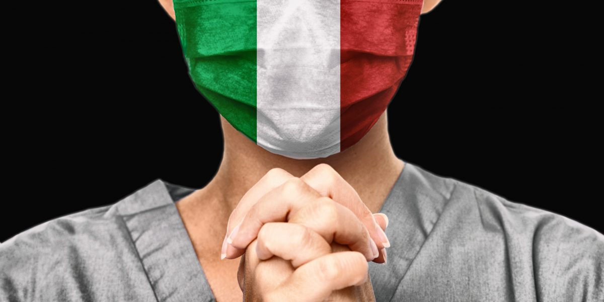 Praying for Italy. Coronavirus pandemic outbreak in Italy. Doctor praying for help. Young woman medical doctor surgeon or nurse portrait.
